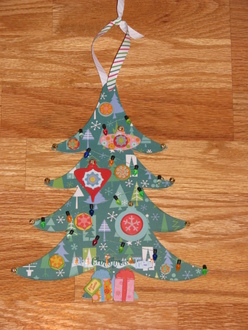 Altered wooden Christmas tree wall hanging