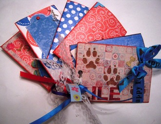 Toilet paper roll mini-album - July Altered Object
