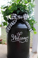 """Recycled """"Welcome"""" Milk Can"""