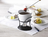White & Black - Revolo Chocolate Fondue Set Perfect for chocolate and hot dips. Pot holds up to 16 ounces/470 milliliters. Fondue pot is kept warm with tea light and features a ceramic bowl and four fondue forks with color coded tips. Dishwasher safe. Package contains four stainless steel forks, ceramic bowl, metal stand, one tea light, recipes and instructions. Imported.