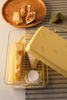Cheese Saver Container to store any type of cheese in the fridge, featuring a removable perforated tray to make it easier to use and clean. This package contains one 6.5x10x4 inch cheese saver. Dishwasher safe. Imported.